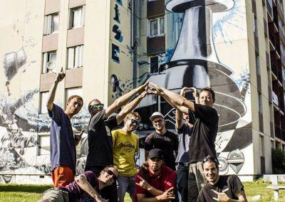 """Graffiti Street art    Le collectif de la Maise devant la fresque murale """" le fou prend la tour """"  située à Aix les bains en 2015"""